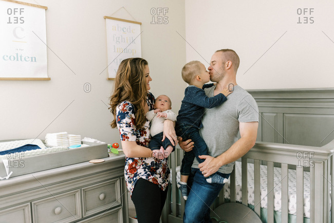 Portrait of a young family with a newborn baby boy and toddler