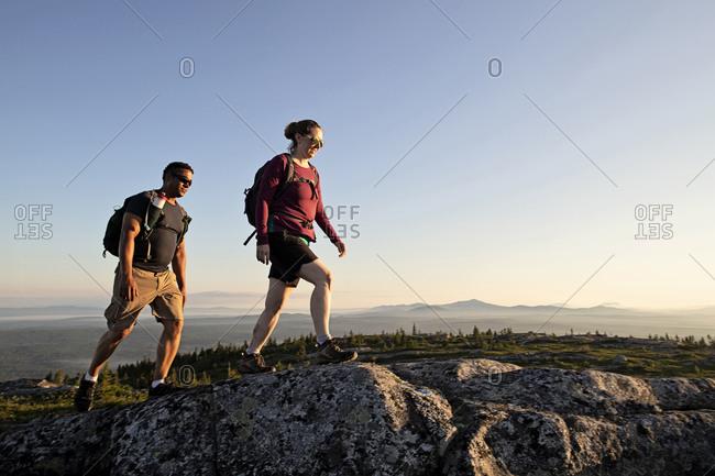 Multi racial couple reach summit of mountain, appalachian trail maine