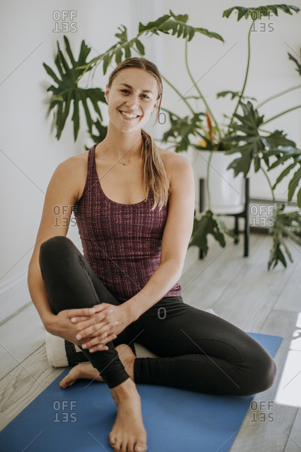 Portrait of fit young caucasian woman indoors in athletic clothes