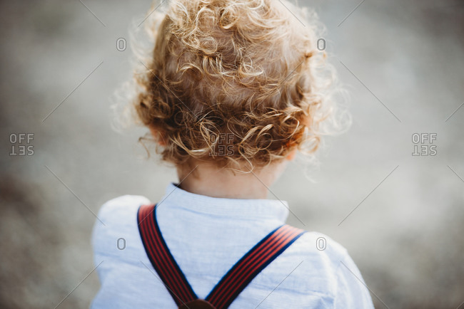 Back view of a young child with lots of blonde curls