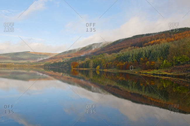 Autumn mist at still lake in the brecon beacons in south wales
