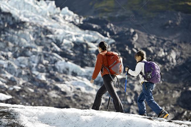 Mother and daughter hiking on vatnajokull glacier in iceland