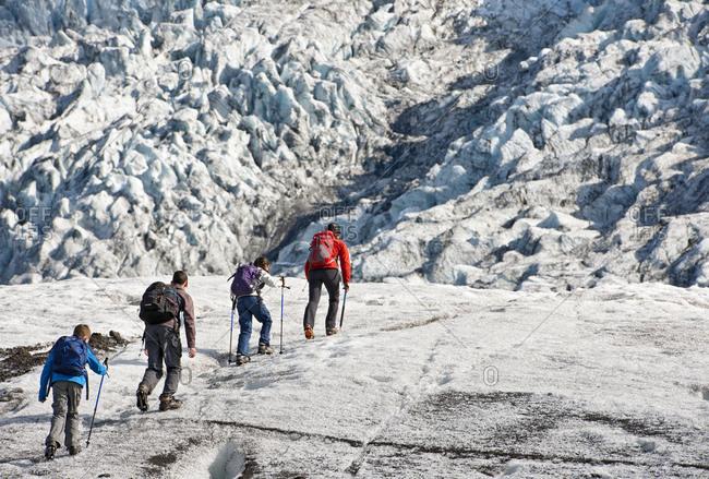 Family exploring the edges of vatnajokull glacier in iceland