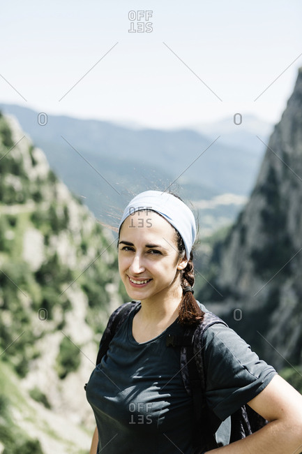 Portrait of a happy woman against a landscaped background