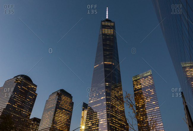 New york, ny, united states - october 17, 2014: shiny facade of wtc one gets reflected over world trade center zone