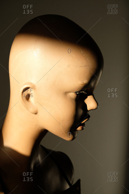 Side view of an old mannequin head without hair