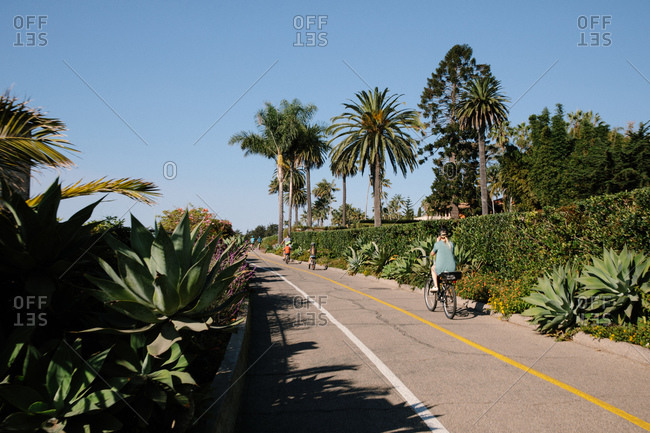 Bikers on path near Butterfly Beach on the coast of Montecito, California