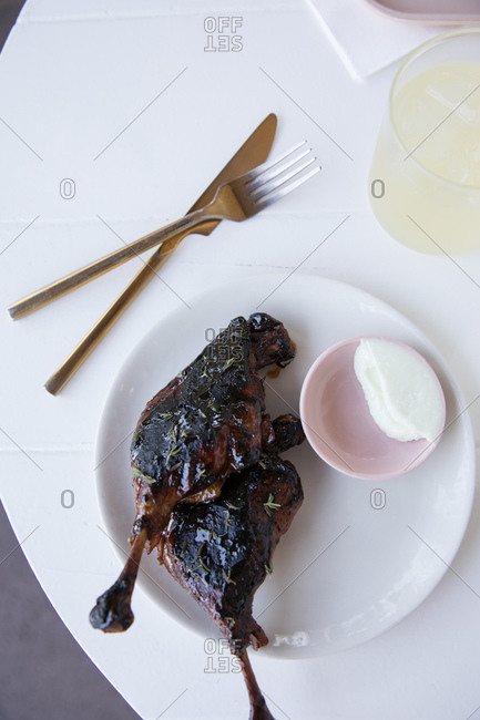 Top view of roasted duck served on white table with lemonade