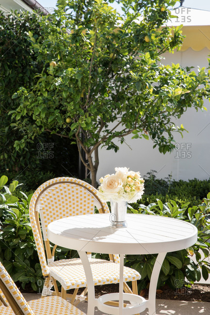 Bistro table outdoor at a luxury hotel on a sunny day