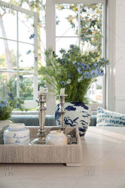Dining room with blue flowers and elegant candlesticks