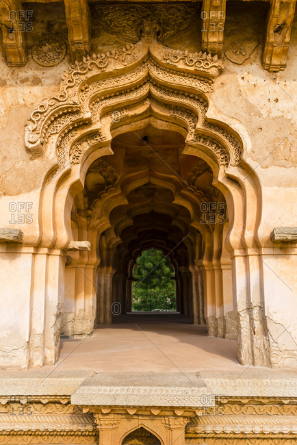 Ornamental granite doors at Lotus Mahal Temple complex in desert valley of Hampi, Karnataka, India