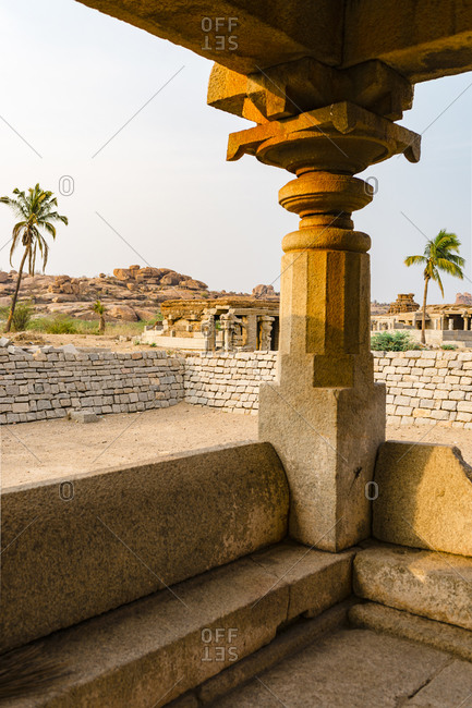 Column at the granite temple complex in ruins in the desert valley of Hampi, Karnataka, India