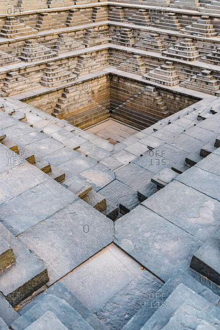 Empty architectural stepped tank of ancient culture in the Hampi region, Karnataka, India
