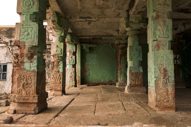 Ancient Virupaksha Temple complex painted green columns, Hampi, Karnataka, India