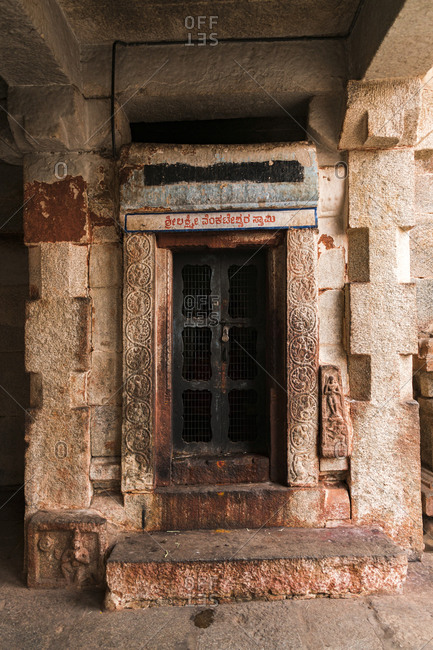 Hampi, Karnataka, India - March 26, 2019: Decorated door in ancient Virupaksha Temple complex in the Hampi region