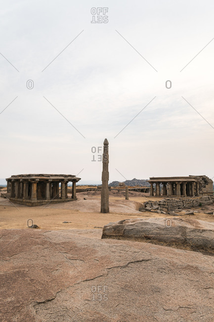Temples and column in ancient Virupaksha Temple complex in the Hampi region, Karnataka, India