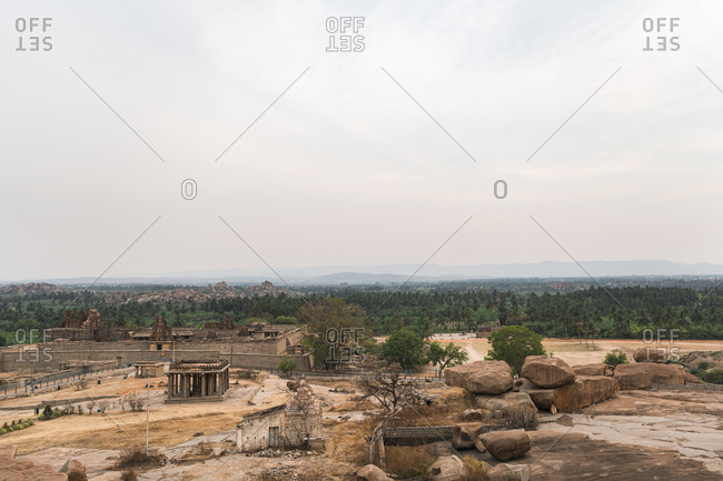 Temples and deserted landscape in ancient Virupaksha Temple complex in the Hampi region, Karnataka, India