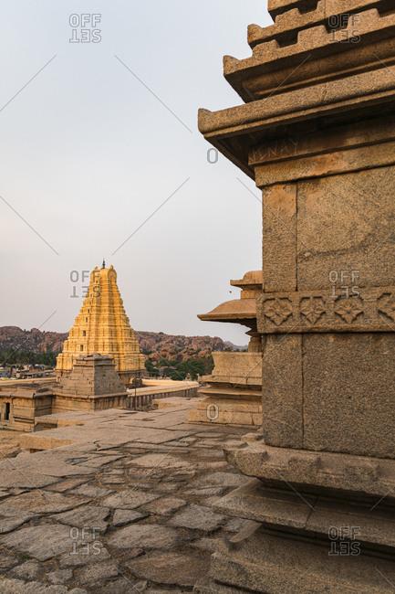 Hampi, Karnataka, India - March 26, 2019: Impressive tower in ancient Virupaksha Temple complex in the Hampi region, Karnataka, India