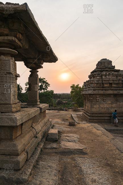 Sunset over the ancient Virupaksha Temple Complex in Hampi, Karnataka, India