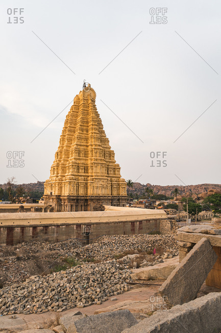 Golden tower and architecture of ancient Virupaksha Temple complex in the Hampi region, Karnataka, India