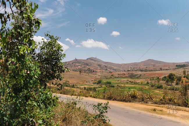 Deserted landscape of dry hills close to a road on a sunny day, Fianarantsoa, Madagascar