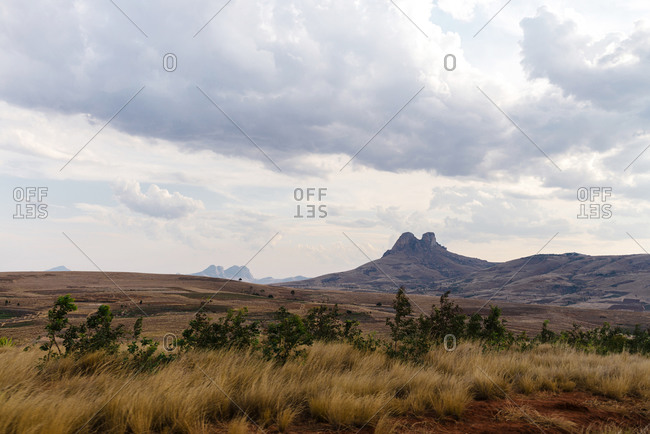 Deserted landscape of dry hills and mountains on a cloudy day at sunset, Fianarantsoa, Madagascar