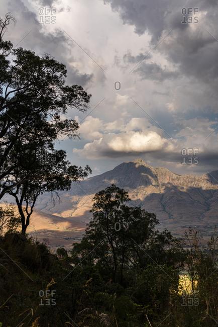 Sun setting over mountain peak in Tsaranoro Valley on a cloudy day, Fianarantsoa, Madagascar