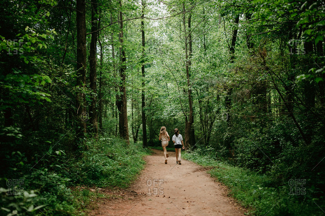 Rear view of two girls hiking in the woods
