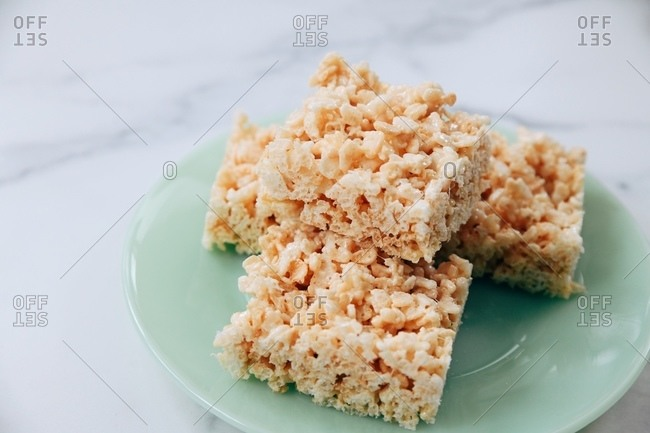 Marshmallow rice cereal treat squares served on a plate