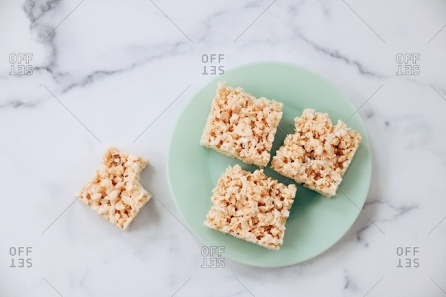 Top view of marshmallow rice cereal treat squares served on a plate