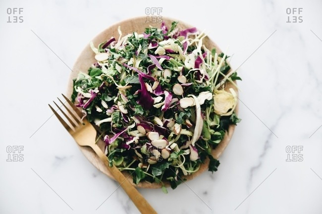 Overhead view of a healthy salad with cabbage and almonds