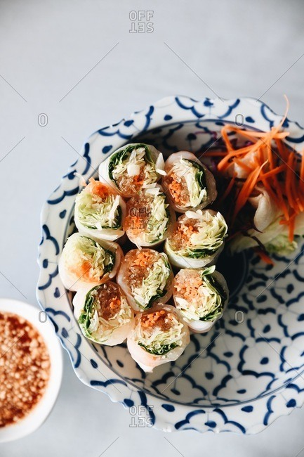 Asian spring rolls served on blue and white plate