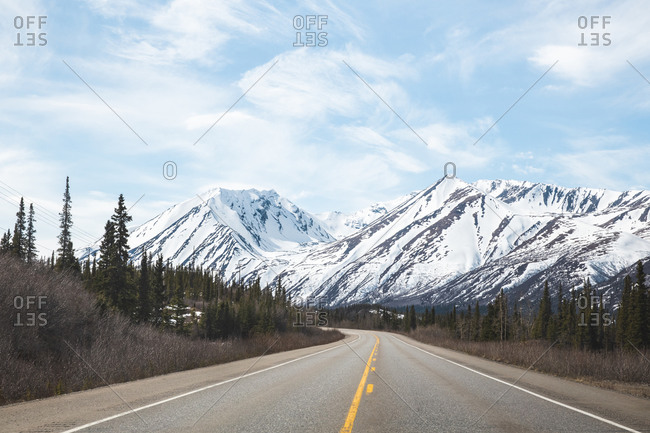 Empty road in the mountains of alaska