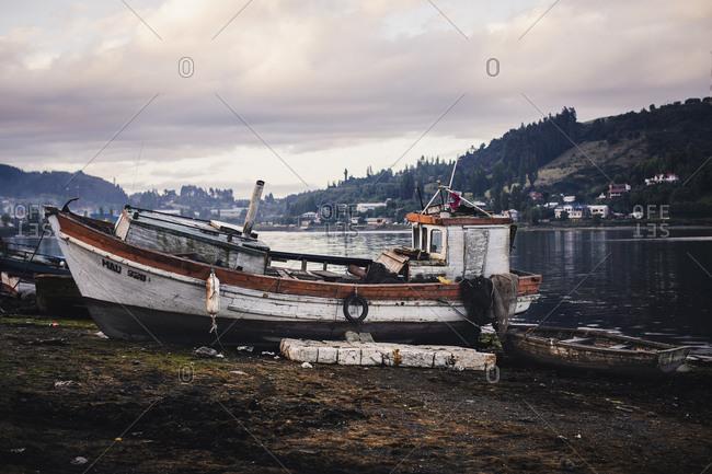 Castro, los Lagos, chile - November 15, 2018: old wooden boat at low tide in Castro Chiloe, chile
