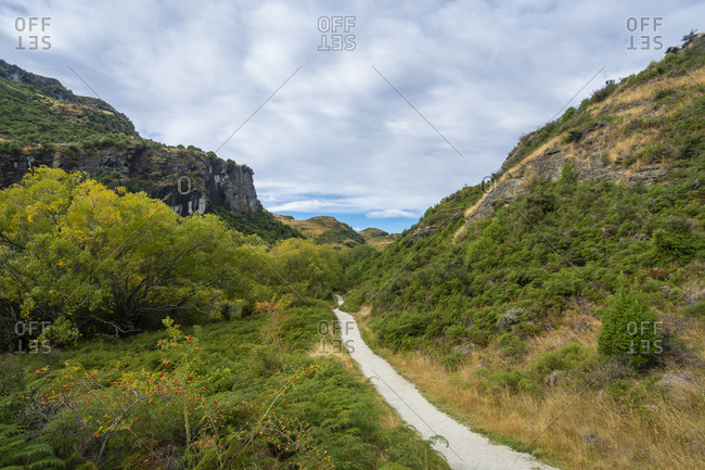 Trail amidst grassy field at diamond lake conservation area, new zealand