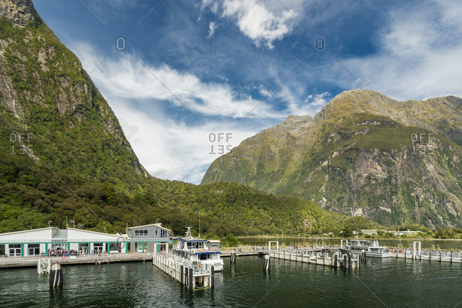 Harbor at milford sound against sky, new zealand