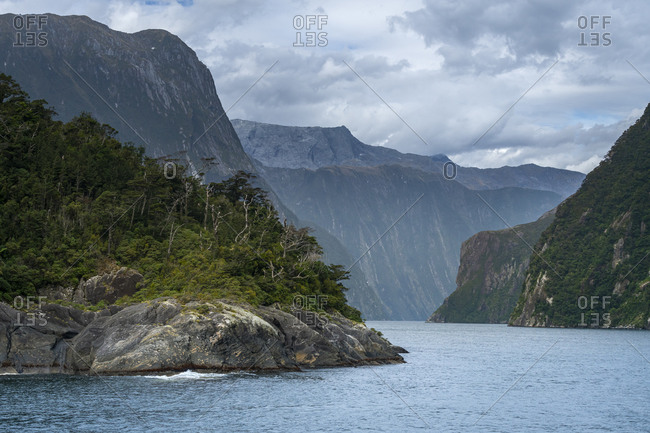 Mountains in milford sound against sky, new zealand