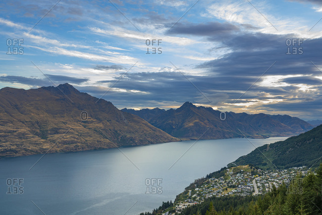 Scenic view of fern hill, sunshine bay and lake wakatipu at dusk, otago region, south island, new zealand