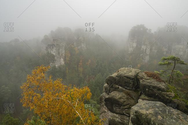 Sandstone rock formation in mist, janova vyhlidka, hruba skala, semily district, liberec region, bohemian paradise, bohemia, Czech republic