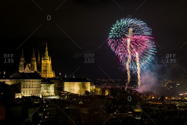 Prague castle with firework display during new year celebration at night, prague, Czech republic