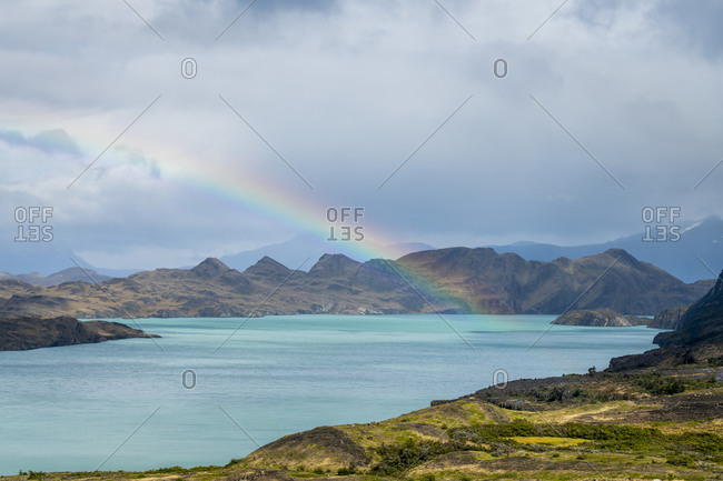 Scenic view of rainbow over lake nordenskjold, Torres del paine national park, Patagonia, chile