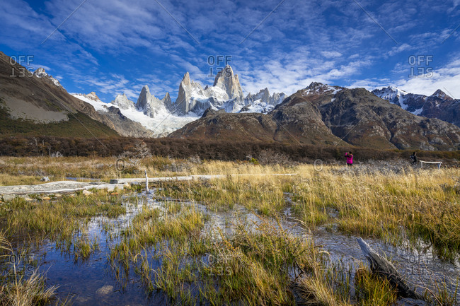 Tourist photographing fitz roy mountain, el chalten, los glaciares national park, Patagonia, argentina