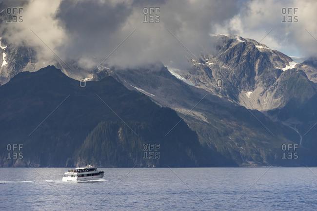 Tourist boat on sea in aialik bay, kenai fjords national park, kenai peninsula borough, southcentral alaska, alaska, usa