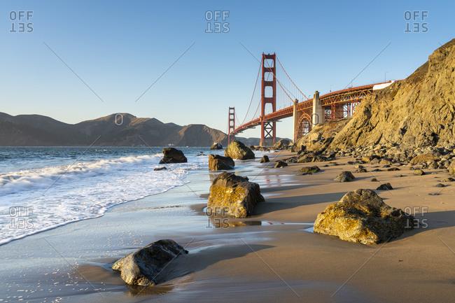 Famous golden gate bridge over bay against blue sky, san francisco, san francisco peninsula, northern california, california, usa