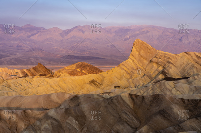 Manly beacon rock formation at zabriskie point at sunrise, death valley national park, california, usa