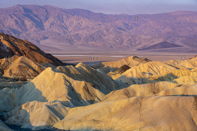 Scenic view of natural rock formations at zabriskie point after sunrise, death valley national park, california, usa