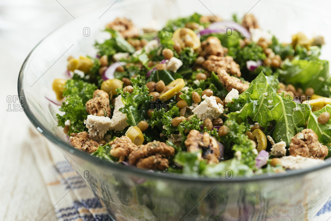 Mediterranean kale and lentil salad with olives and vegan feta