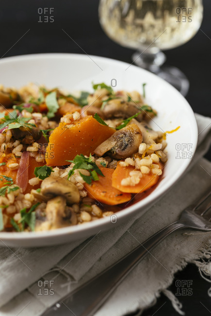 Winter squash with mushrooms, carrots barley crookened in white wine