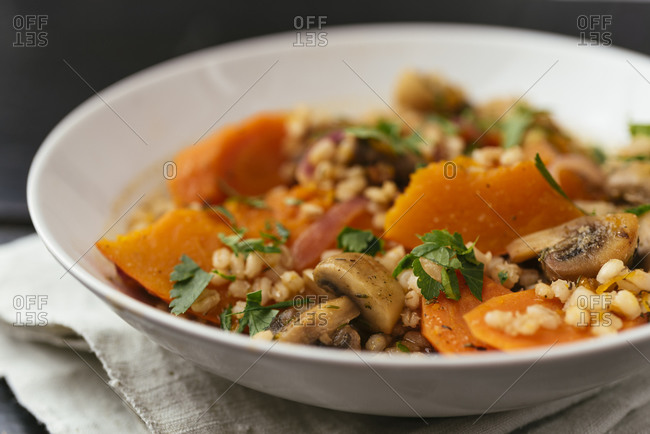Winter squash with mushrooms, carrots barley crookened in white wine.