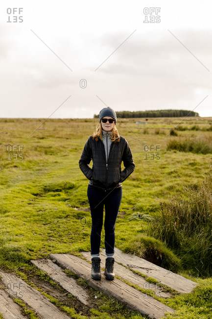 Red headed woman going for a walk in the english countryside